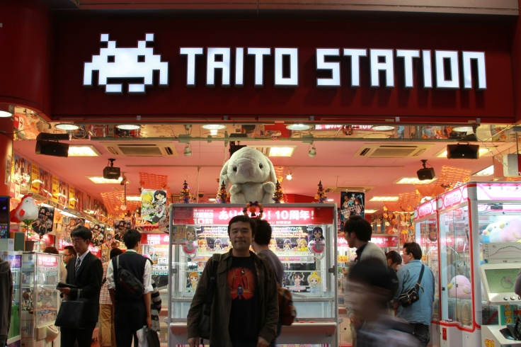 Standing in front of the legendary Taito Station.